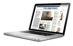MacBook Pro displaying The Times website.